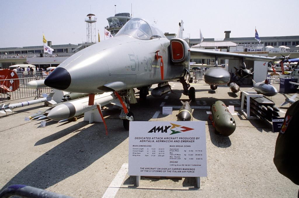 A front right side view of an Italian-Brazilian AMX aircraft on display at the 38th Paris International Air and Space Show at Le Bourget Airfield.