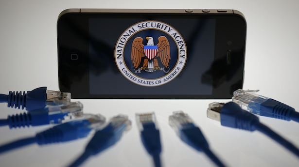 An illustration picture shows the logo of the U.S. National Security Agency on the display of an iPhone in Berlin