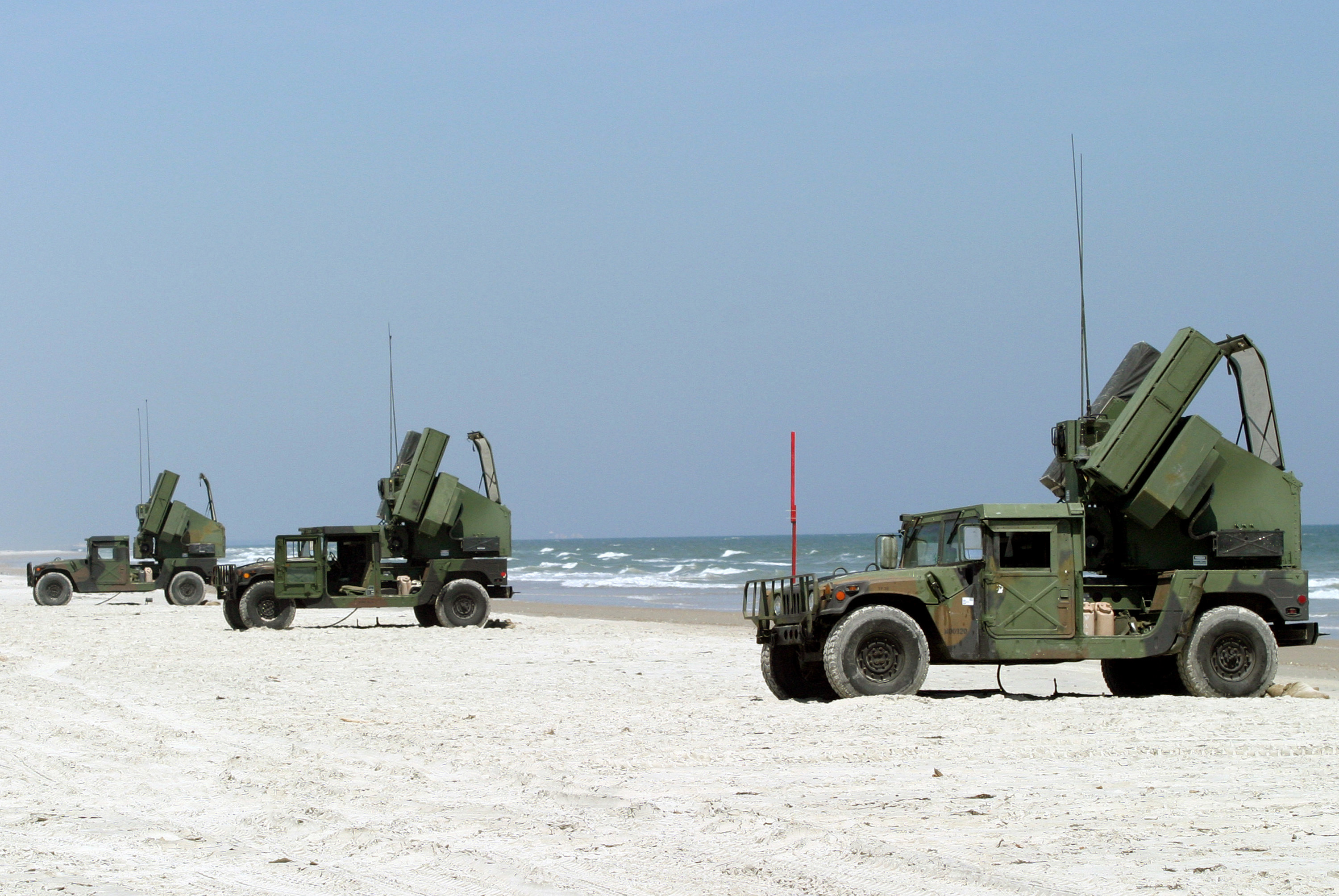 Three US Marine Corps (USMC) M1097 ÒAvenger,Ó Pedestal Mounted Stinger System, assigned to Alpha Company, 2nd Low Altitude Air Defense (2LAAD) Squadron, in place during the Battalion Fire Exercise (BNFEX), at Onslow Beach, Camp Lejeune, North Carolina (NC).