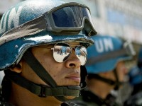 Brazilian peacekeepers from the United Nations Stabilization Mission in Haiti (MINUSTAH) provide security at a voting center in Cité Soleil, during the second round of the senatorial elections in Port-au-Prince, Haiti.