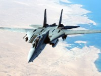 A US Navy (USN) F-14D Tomcat aircraft flies a combat mission in support of Operation IRAQI FREEDOM.