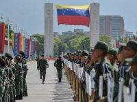 """Venezuelan National Guard personnel take part in the launching ceremony of the """"Plan Republica"""", the security operation for the presidential election on May 20, in Caracas, on May 15, 2018. (Photo by Luis ROBAYO / AFP)        (Photo credit should read LUIS ROBAYO/AFP/Getty Images)"""